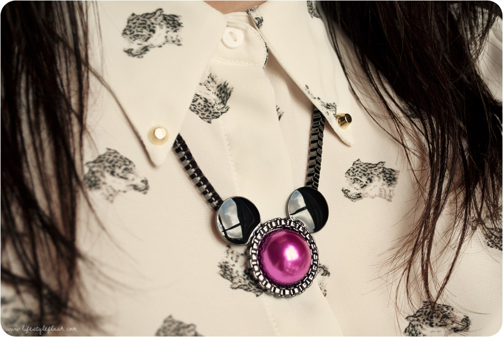 Outfit detail: Mawi for Minnie necklace, Zara animal print buttoned-up blouse with studded collar