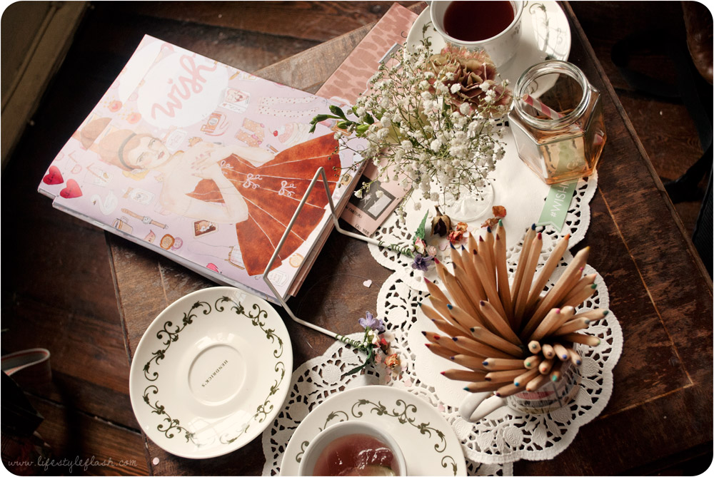Wish launch party - Wish magazine on a coffee table with coloured pencils, floral posies and teacups and saucers
