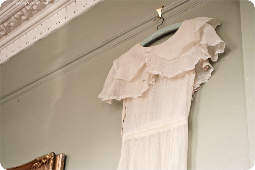 Wish launch party - vintage cream dress hung on the wall