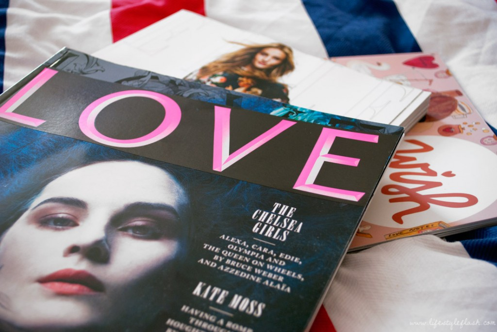 LOVE magazine AW12 (Issue 8), on top of a stack of magazines