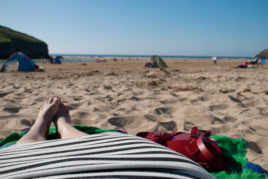 Sunbathing on Mawgan Porth Beach, Cornwall