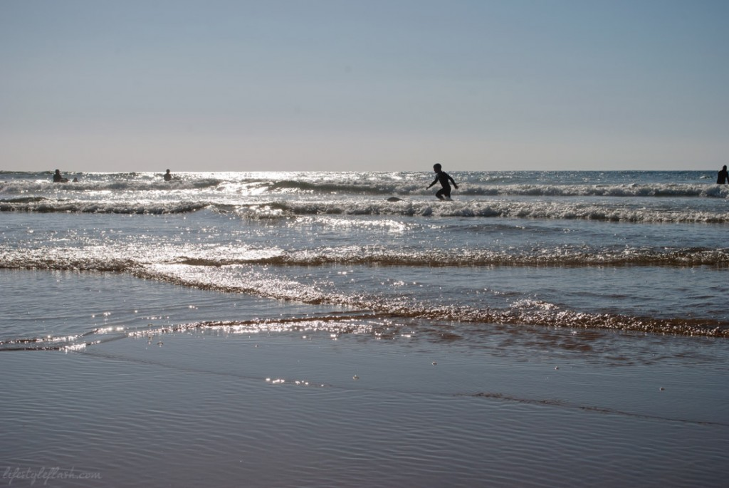 Surfers on Mawgan Porth Beach, Cornwall