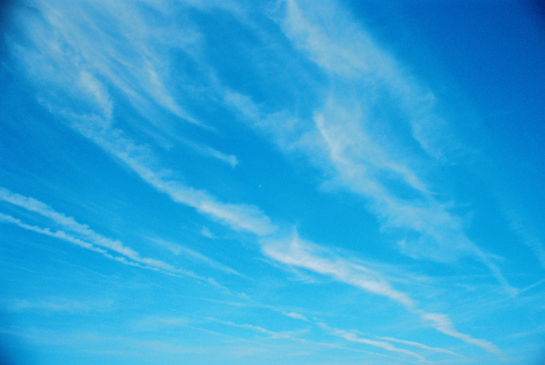 Stunningly blue, cloud-streaked sky