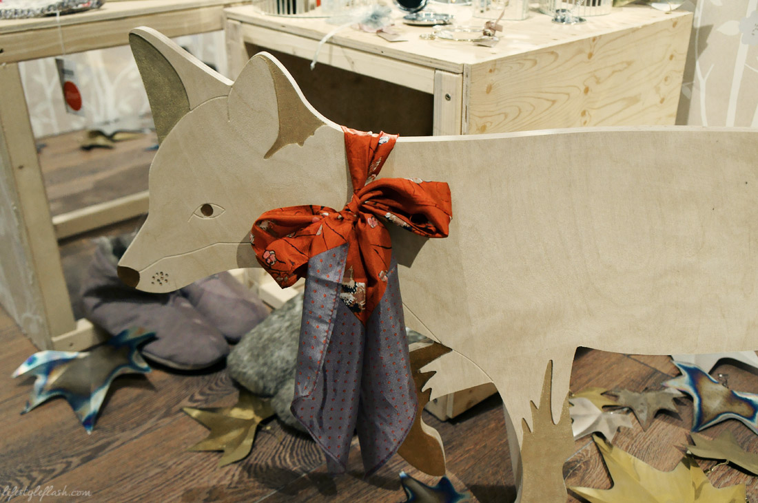 Wooden fox wearing AW12 scarf at the Laura Ashley blog birthday party