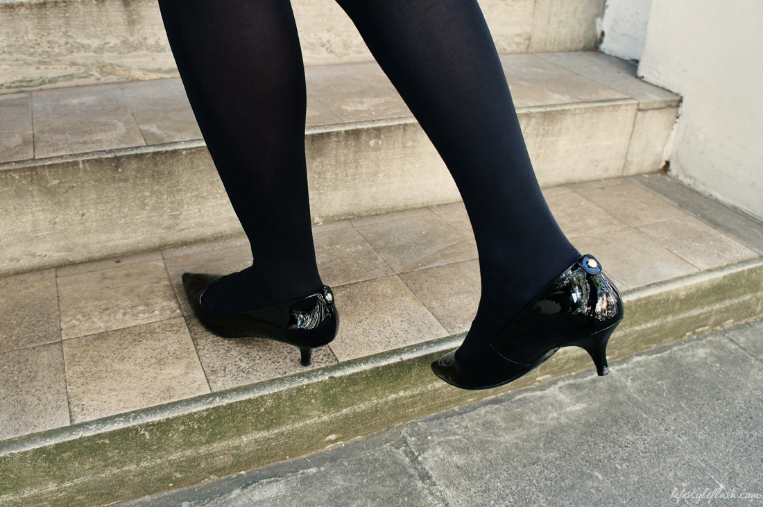 1960s-style black patent leather kitten heels by Michael Kors