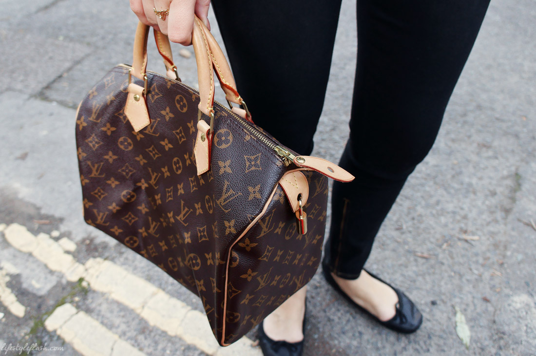Louis Vuitton Speedy handbag, black skinny jeans, leather ballet pumps