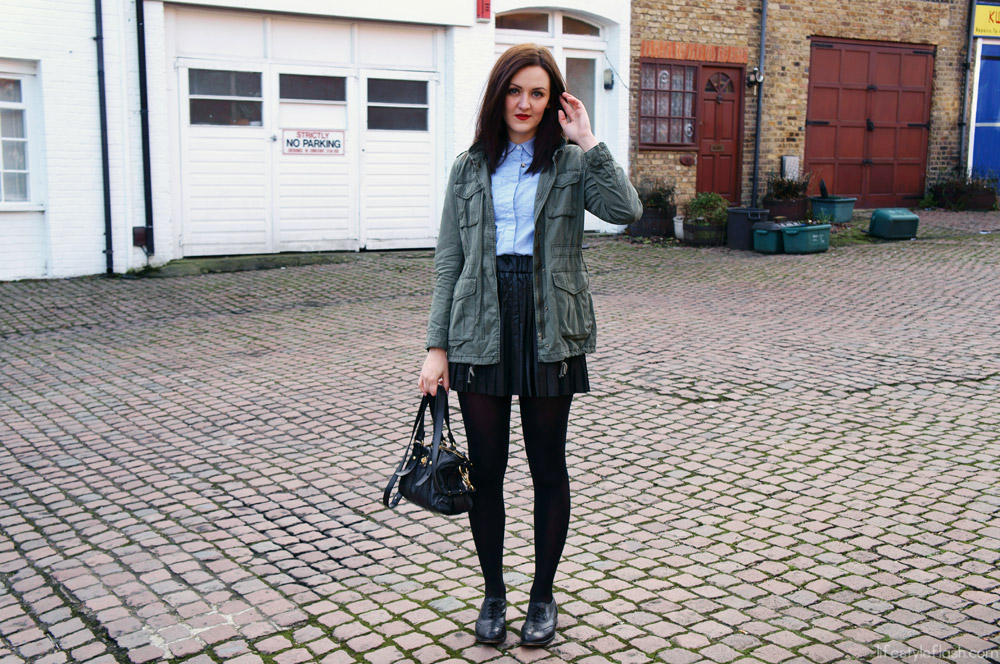 Pleated leather skirt, blue button-up shirt, army jacket