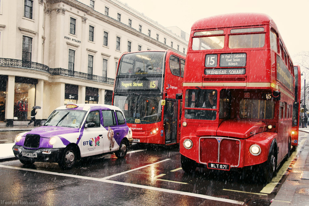 Old London Routemaster bus and black cab in the snow