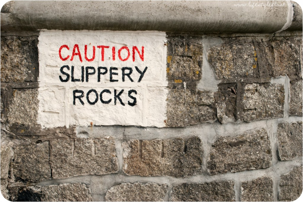 """Cornwall: """"Caution - slippery rocks"""" sign in Gorran Haven"""